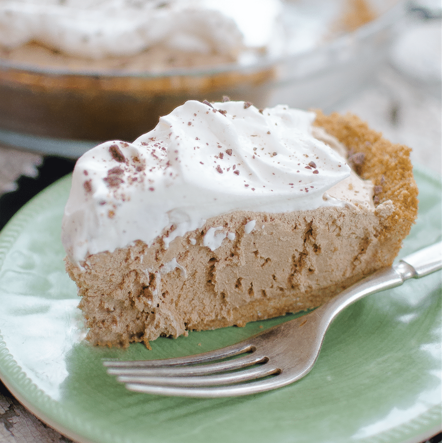 This homemade Chocolate Silk Pie recipe with freshly whipped cream is smooth & creamy, sweet & rich. It's the BEST no-bake treat for hot summer days.