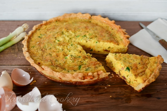 Farm Fresh Quiche Lorraine made with eggs, cream, bacon, onions, and herbs in a shortbread crust. Rich and hearty and utterly delicious!