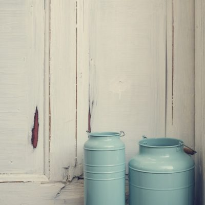 Vintage milk canisters.