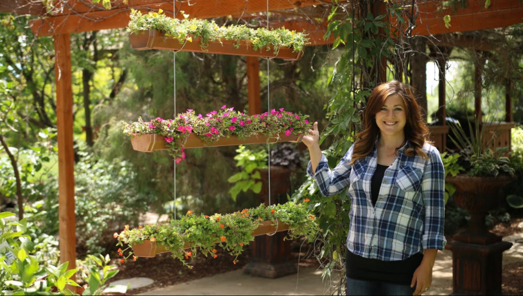 woman with her indoor herb garden