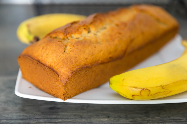 banana cake in a plate surrounded with bananas