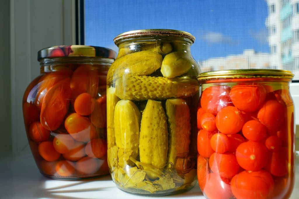 Three jars full of various easy canning recipes