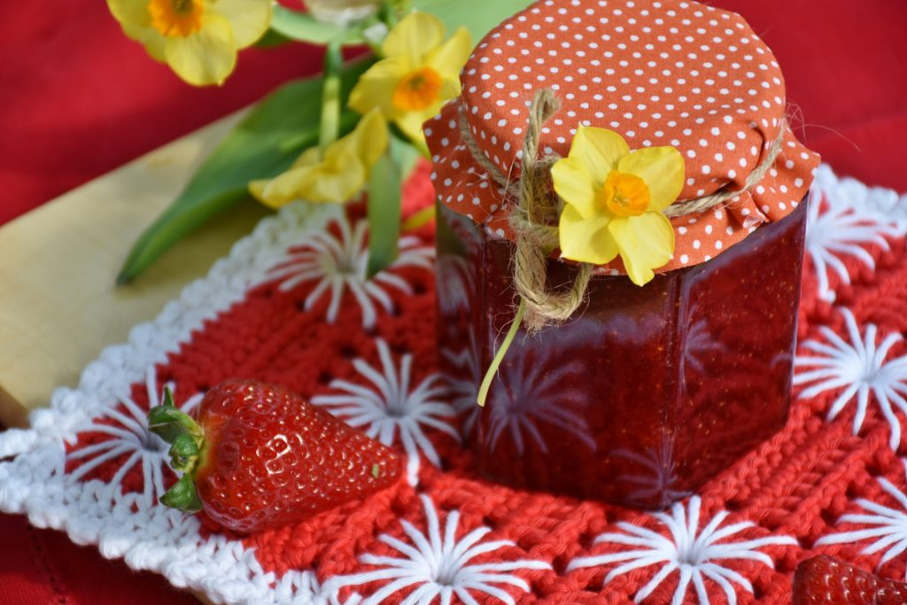 A jar of strawberry jam, which is one of our easy canning recipes